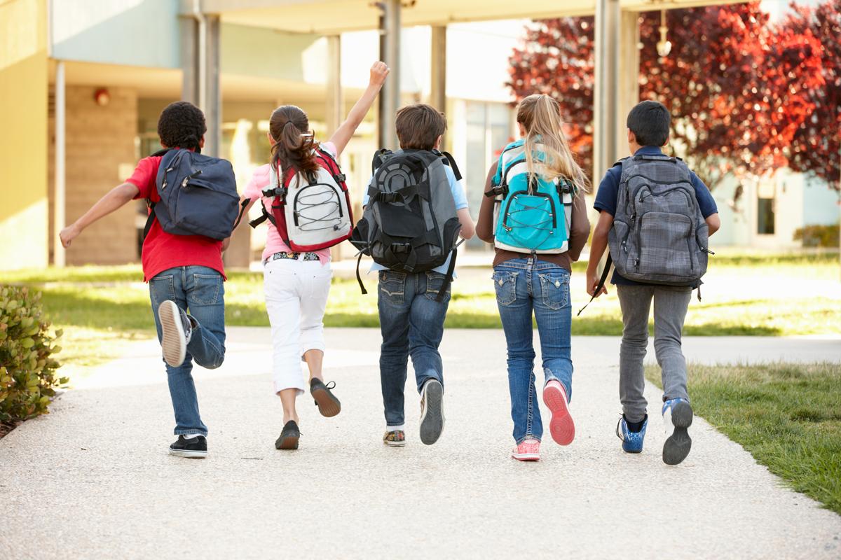 School kids walking outside